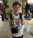 One of our players from our 5th and 6th boys travel team holding the runner up trophy from the CYC Tournament!